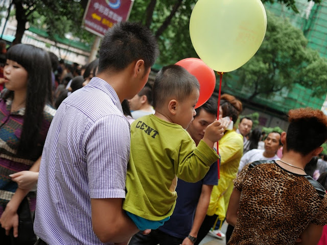 little boy holding a balloon in Shenzhen
