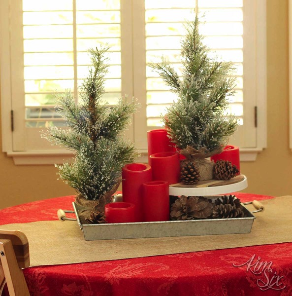 Christmas centerpiece with candles and pinecones