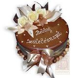 58. kép: Ünnepi torták - Csokitorta rózsákkal és szalaggal