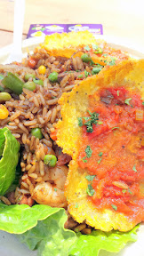 Que Bacano Colombian Food at Portland Mercado, here the Arroz Mixto main dish which is a Colombian version of fried rice with chicken, pork, shrimp, and more and served with two patacones or fried green plaintains