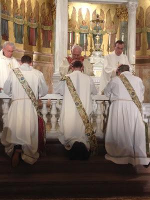Msgr. John Grabish laying hands on Fr. John during the ordination.
