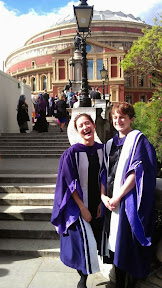 Gratuitous photograph of me on graduation day, complete with purple robe.