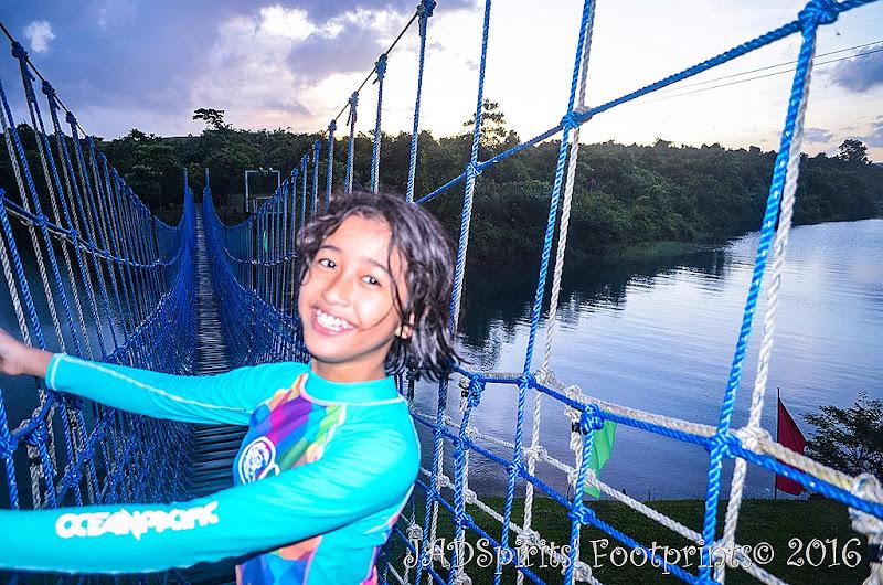 My daughter's photo op in the hanging bridge at Caliraya Mountain Lake Resort