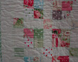 Detail of Fancy That quilting design on Lisa's sashed 9-patch quilt