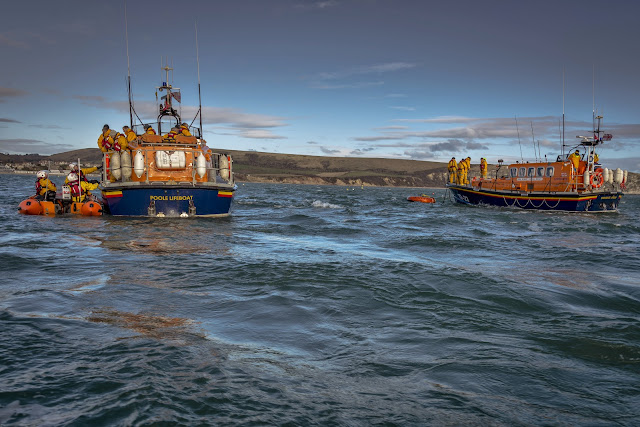 Poole and Swanage lifeboats, with the Swanage Mersey class on its floating mooring.  Photo credit: Andy Lyons, Swanage RNLI