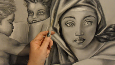 Work in progress at Dead Layer underpainting stage, also known as Verdaccio. Showing close up of face. Hand holding a paintbrush included in the photograph to confirm scale.