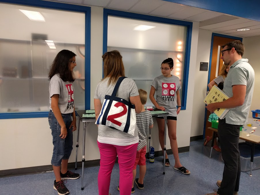 Parents stopping by to learn about FLL Jr.