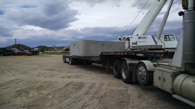 flatbed trailer loaded with large cement box