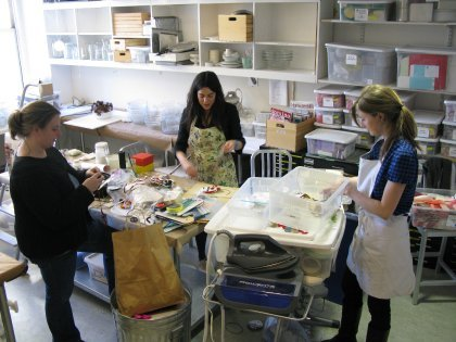 Sorting through craft supplies in our old workroom