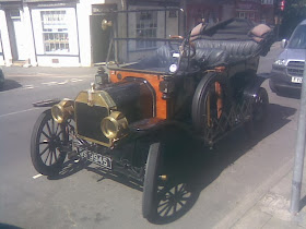Vintage car on sunny street looking like chitty chitty bang bang