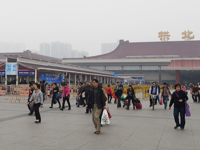 People in Zhuhai walking away from the border gate with Macau