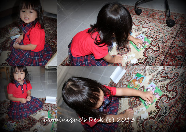 Tiger girl fixing a puzzle
