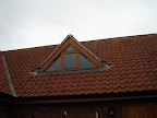 Bespoke triangular dormer window in softwood and stained