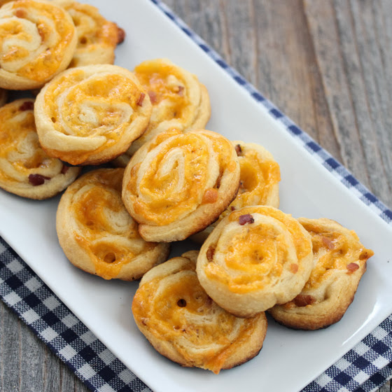 overhead photo of Bacon Cheddar Pinwheels on a serving platter