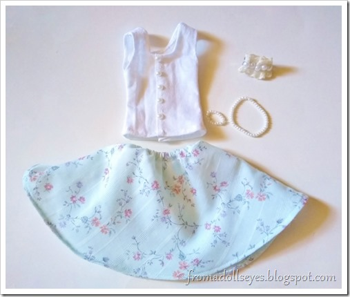 A cute outfit for  a ball jointed doll.  A white tank top with