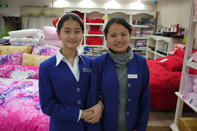 Two woman wearing Santa hats in Putian China