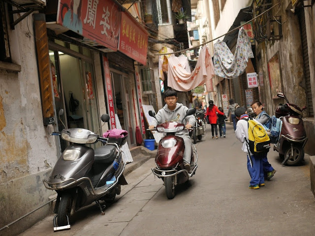 person on scooter at Wuya Lane in Shaoguan, Guangdong