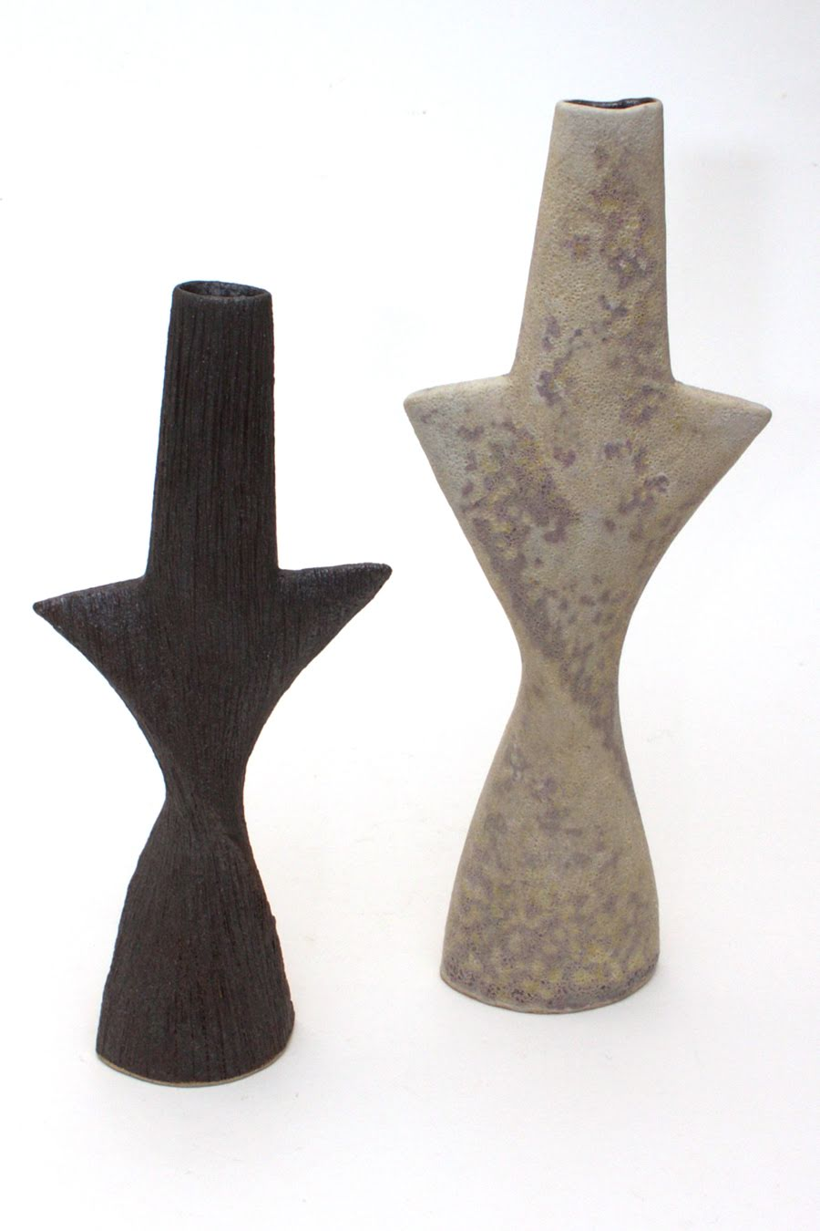 Pair of ceramic twisting totemic forms by Chris Carter