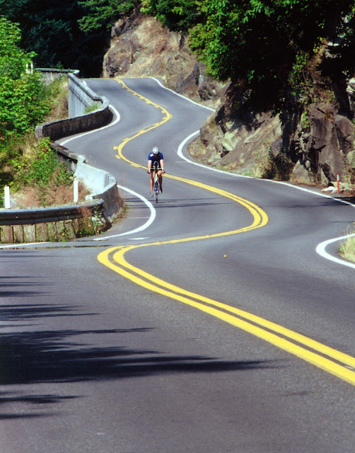 Along Chuckanut Drive, bicyclists enjoy spectacular views of the islands and inland waters off the northwest Washington coast.Credit: Robert James