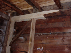 Like the girts one floor above, this girt has a free tenon and three inch beech planks added to support the girt.  The brace above the girt had a keyed tenon repair.