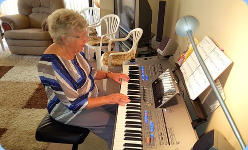Our host, Barbara Powell, playing her Yamaha Tyros 5.