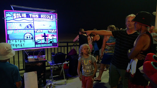"""Another example of walking a man through """"The Riddle"""" message. Chris' daughter, Chloe, is looking on and learning at a young age that it is totally okay to talk to people about Jesus. #ParentingWin"""