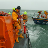 Poole ALB in a training exercise with Swanage lifeboats - Poole crew practising throwing a heaving line to transfer a tow rope - 26 January 2014.  Photo credit: RNLI Poole/Rob Inett