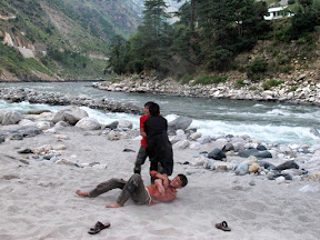 Local kids playing Kabbadi on the bank of the river.