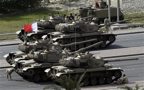 Bahraini army tanks take position near Pearl Square in Manama on February 17, 2011. Riot police stormed through the square firing rubber bullets and tear gas in a harsh crackdown on anti-regime protesters that left four dead, witnesses and opposition said.  (AFP/Getty photo by Joseph Eid)