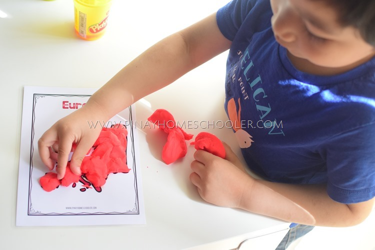 Working on the Europe Continent Playdough Mat