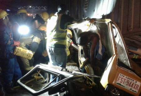 Container Falls On Two Fully Loaded Danfo Buses In Ojota (Photos)