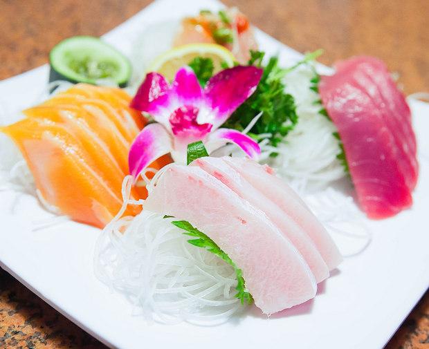 photo of a plate of tuna, salmon, yellowtail, albacore sashimi
