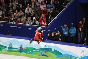 Charles Hamelin hugging his girlfriend after his race