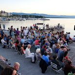 large local crowd at Bains des Paquis in Geneva in Geneva, Geneva, Switzerland