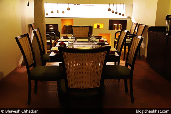Seating arrangement near the kitchen of Savya Rasa [Koregaon Park, Pune]