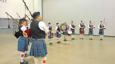 The music of the Centennial State Pipes and Drums that are playing to greet the GABF attendees as they enter