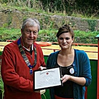 22nd October 2014.  Lion President Brian Hersee presenting Kate of the Lock Inn with a Certificate of Appreciation for their tremendous efforts in selling our 2014 Summer Quiz Booklets.