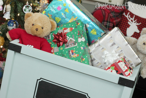 Filling toybox with presents for christmas morning