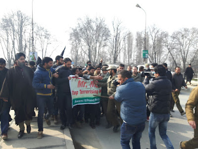 Scores of AIP workers defying strict police restrictions managed to carry a strong protest march in Srinagar today against the killings