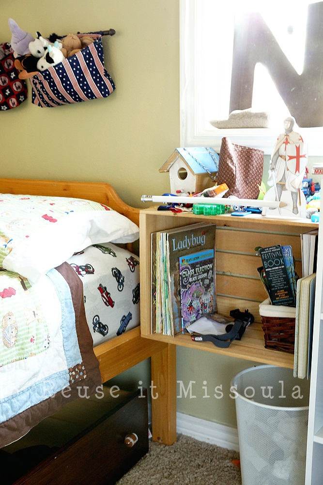 Reuse It - Wooden crates mounted on the wall make perfect nightstands.