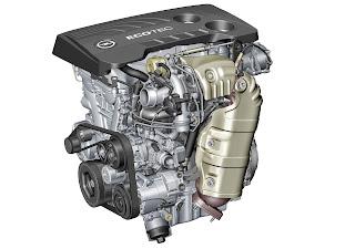 Sopra, il motore ECOTEC di Opel, l'1.6 SIDI con in primo piano il gruppo di sovralimentazione.