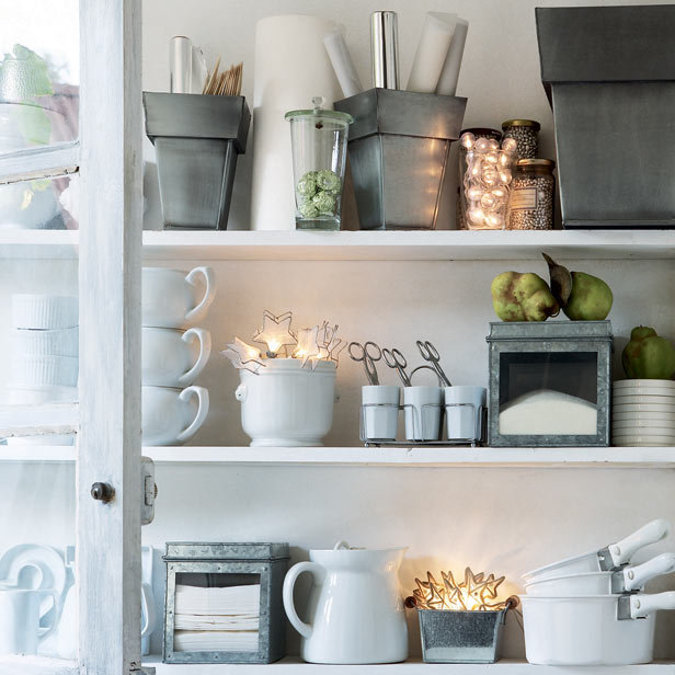 White shelves with galvanized kitchen accessories