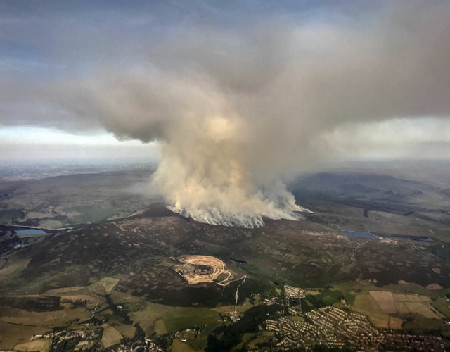 Aerial view of the fire on Saddleworth Moor sending huge plumes of smoke into the sky, 27 June 2018. Photo: SWNS