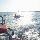 Poole ILB towing broken down speedboat to Baiter slipway after it was picked up next to Poole Lifeboat Station 12 June 2014 Photo: RNLI Poole