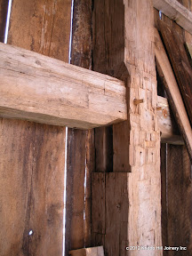 This original post had two sets of mortises for the middle and lower girts.  There was no evidence of plugs or packing pieces.