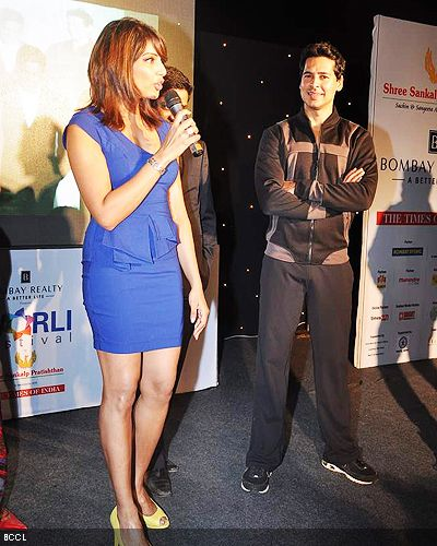 Bipasha addresses her fans as Dino Morea looks on during the launch of Dino's fitness brand in Mumbai. (Pic: Viral Bhayani)
