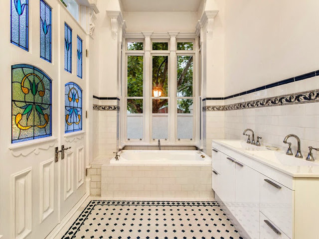 Beautiful Art Nouveau patterns in the bathroom leadlight and the tiled bathroom frieze