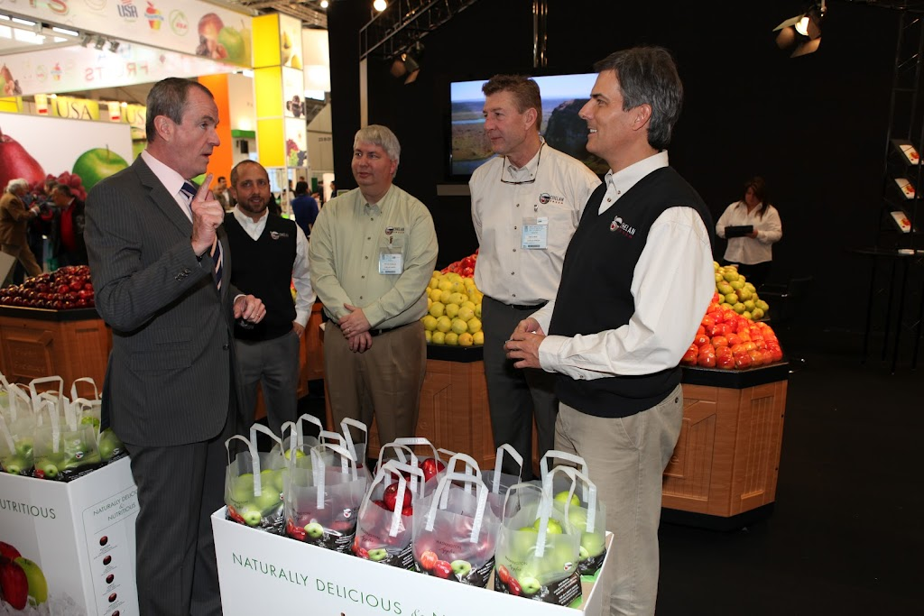 Ambassador Murphy engaged in conversation with U.S. exhibitors at the Fruit Logistica in Berlin 2012
