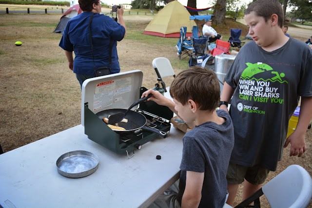 Young Scouts cooking Talapia for dinner