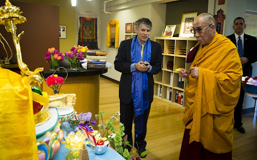 His Holiness the Dalai Lama blessing the Red Tara statue in the reception area of FPMT International Office, Portland, Oregon, U.S., May 10, 2013. Photo by Leah Nash.